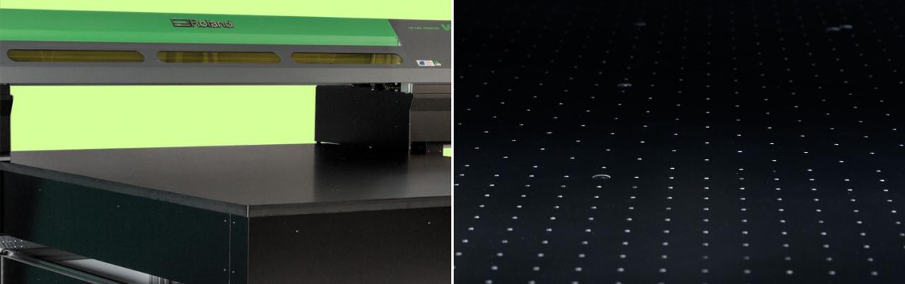 Gros plan du plateau et du système d'aspiration de l'imprimante à plat VersaUV série S